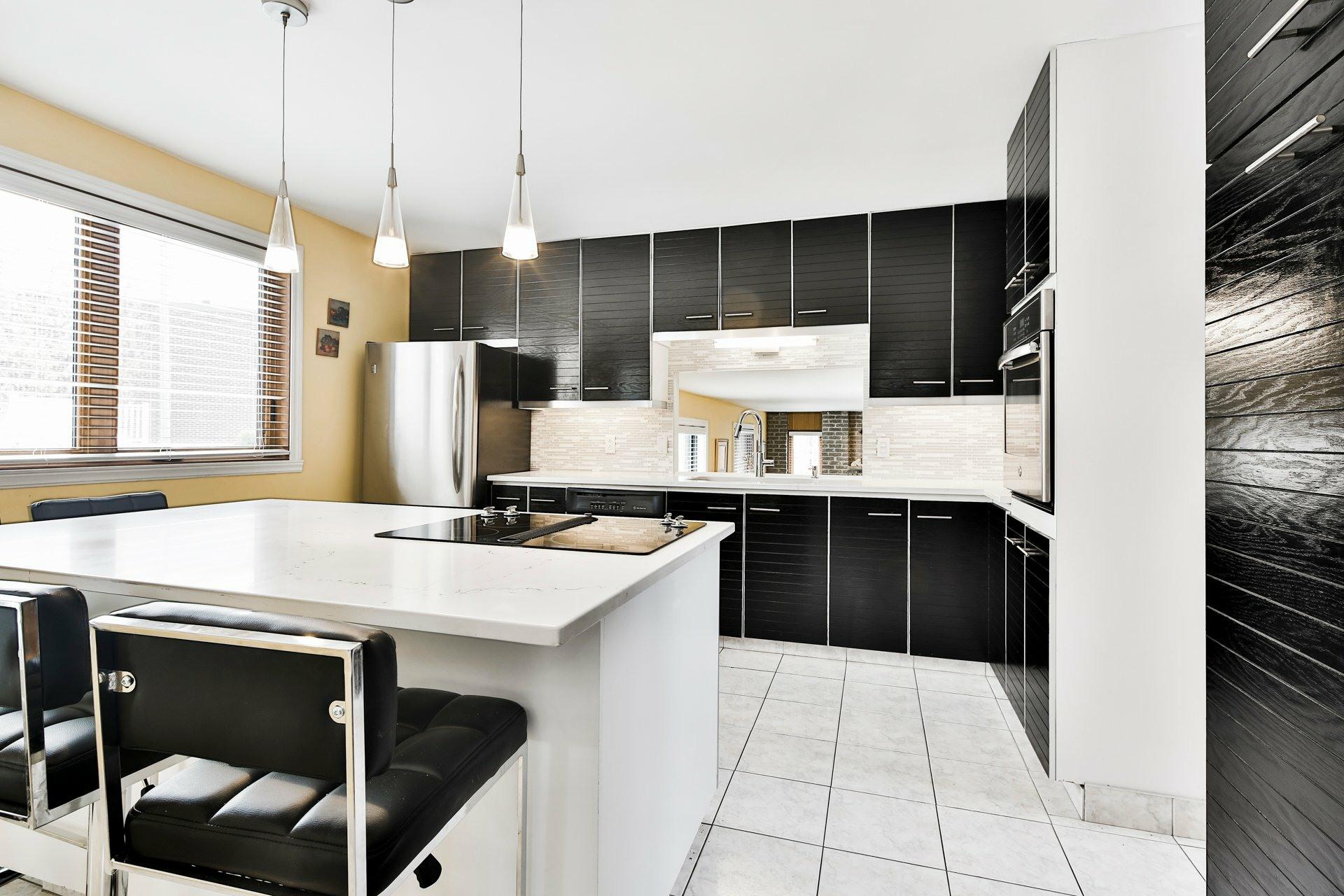 image 9 - Maison À vendre Laval Duvernay  - 13 pièces