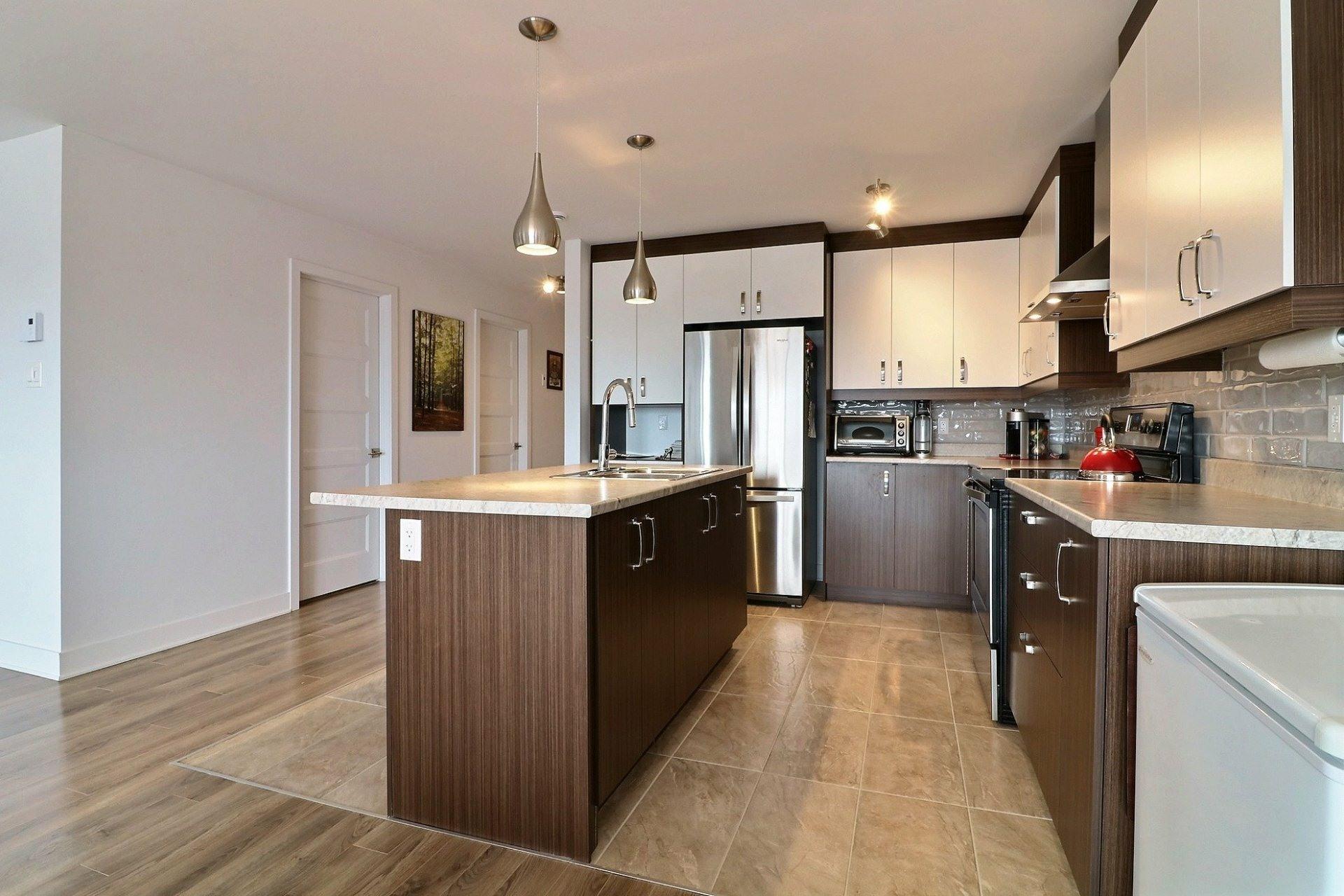 image 3 - Appartement À vendre Sainte-Marthe-sur-le-Lac - 10 pièces