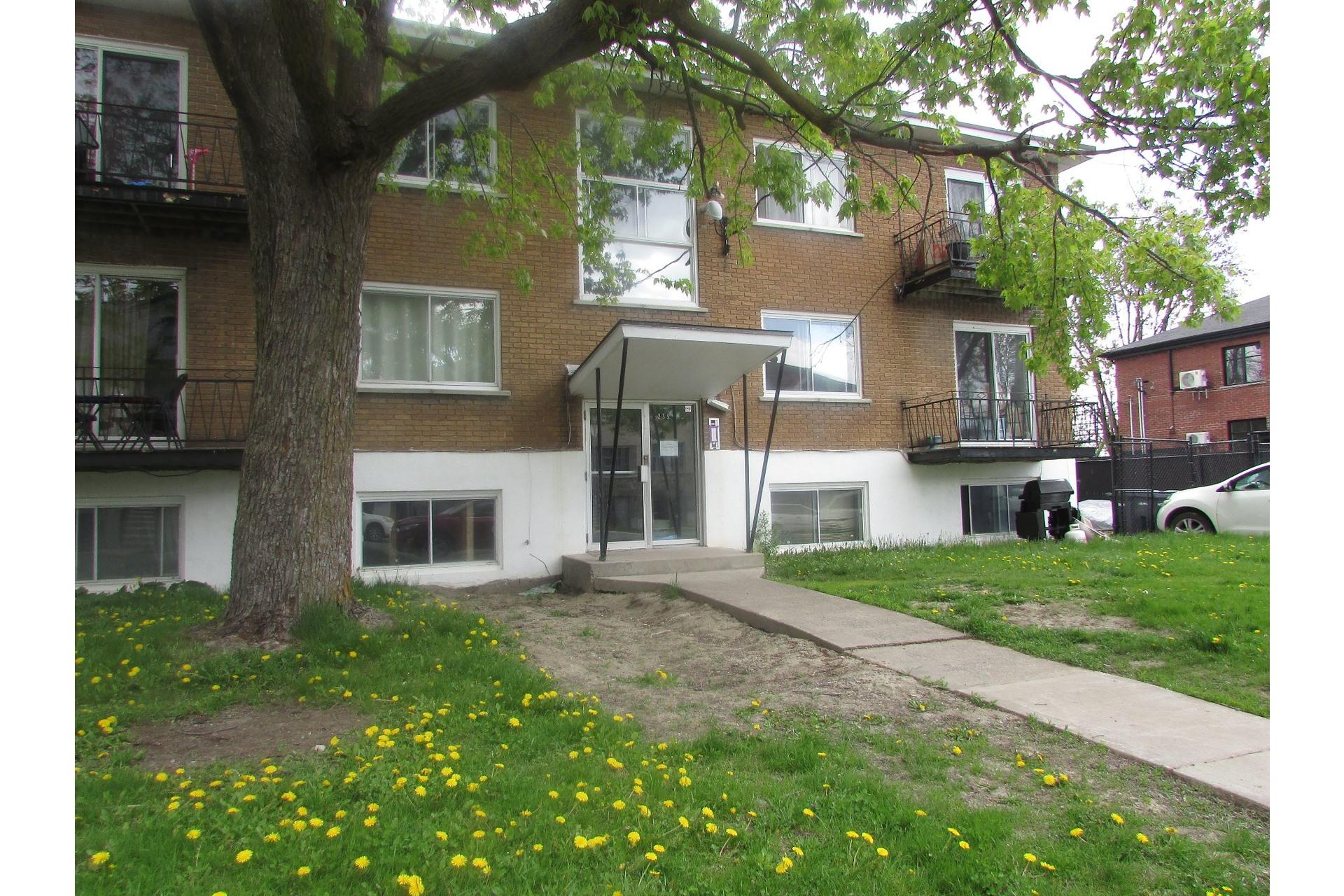 image 1 - Immeuble à revenus À vendre Duvernay Laval  - 5 pièces