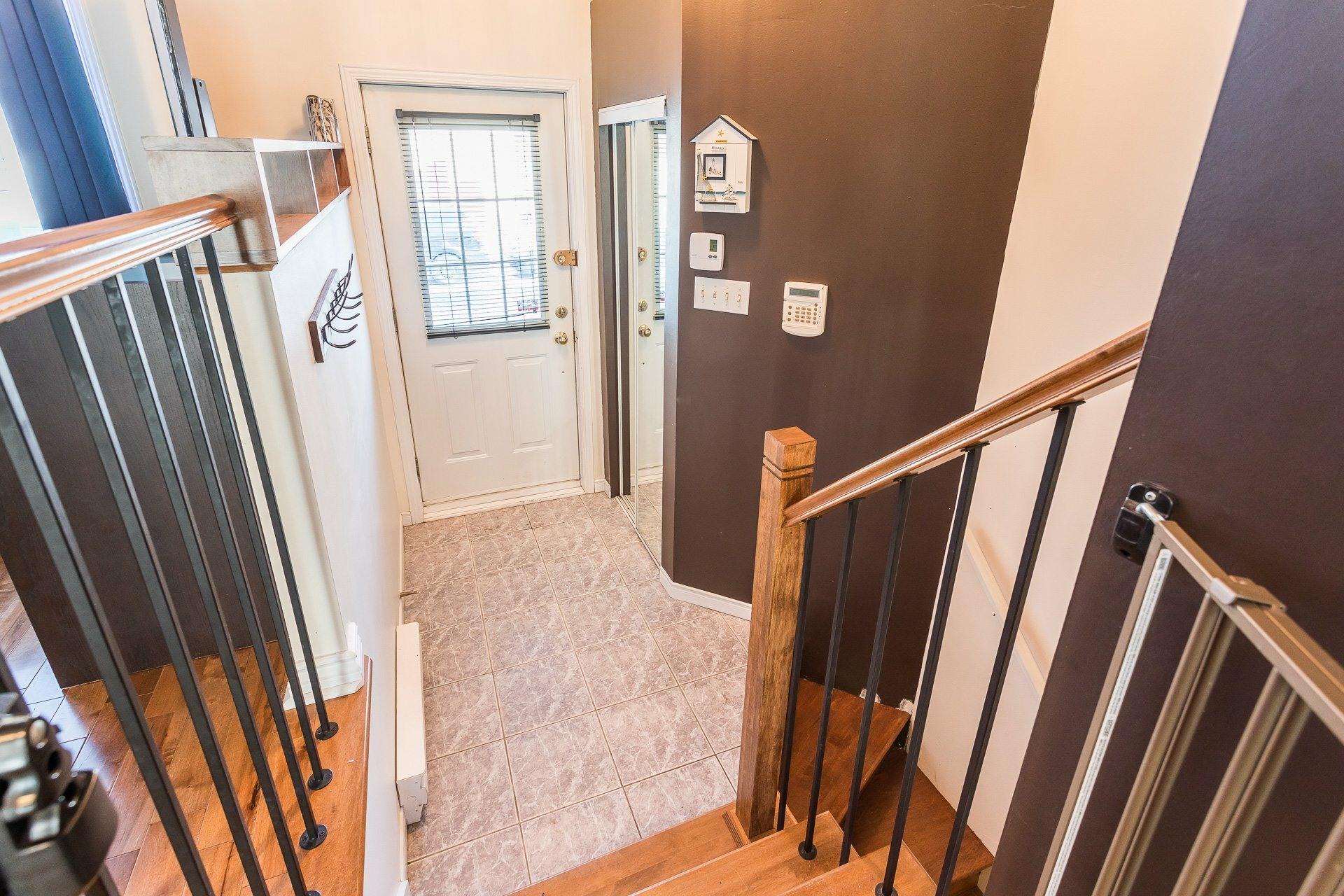 image 2 - House For sale Rivière-des-Prairies/Pointe-aux-Trembles Montréal  - 9 rooms