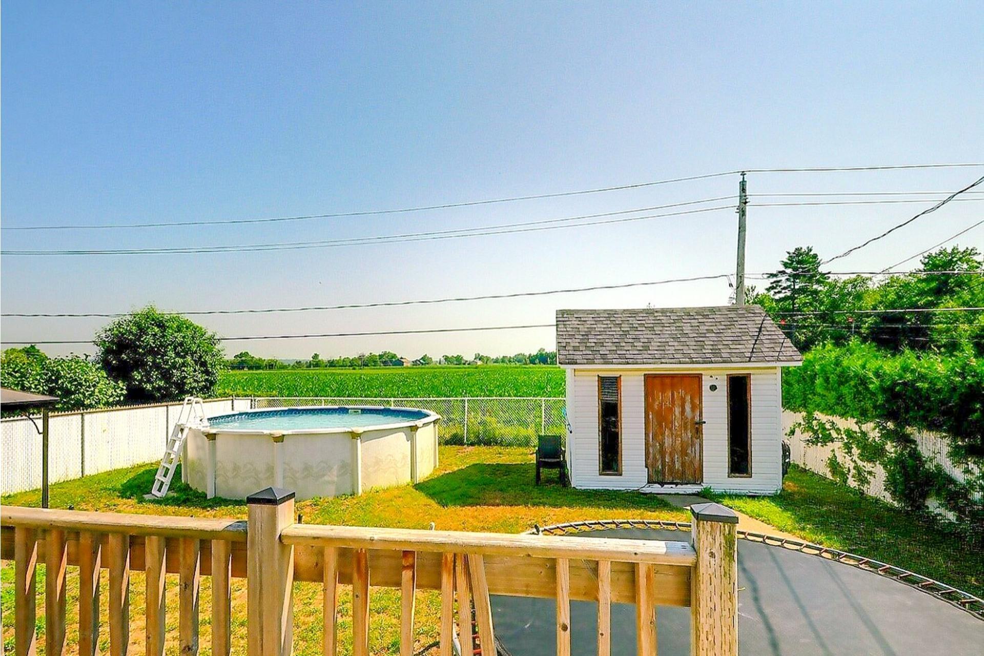 image 18 - Maison À vendre Sainte-Anne-des-Plaines - 9 pièces