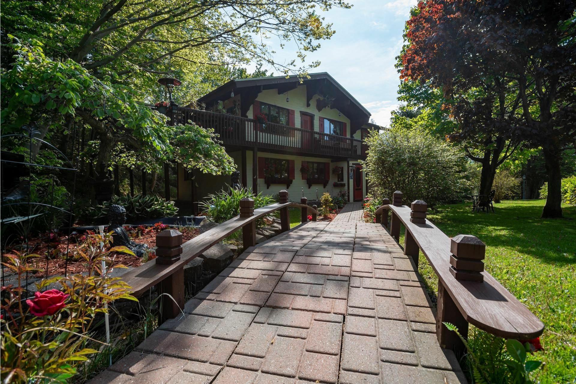 image 1 - Maison À vendre Lac-Beauport - 12 pièces