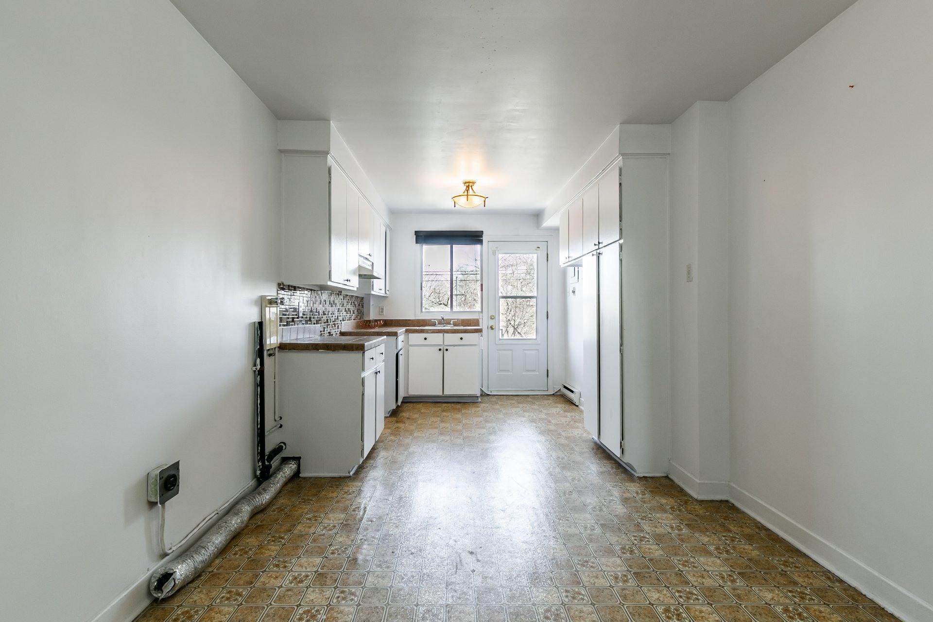 image 2 - Apartment For rent Anjou Montréal  - 5 rooms