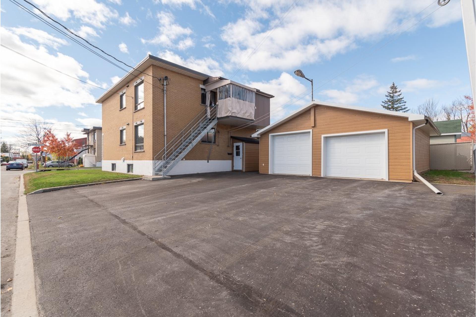 image 0 - Duplex À vendre Sainte-Anne-des-Plaines - 5 pièces