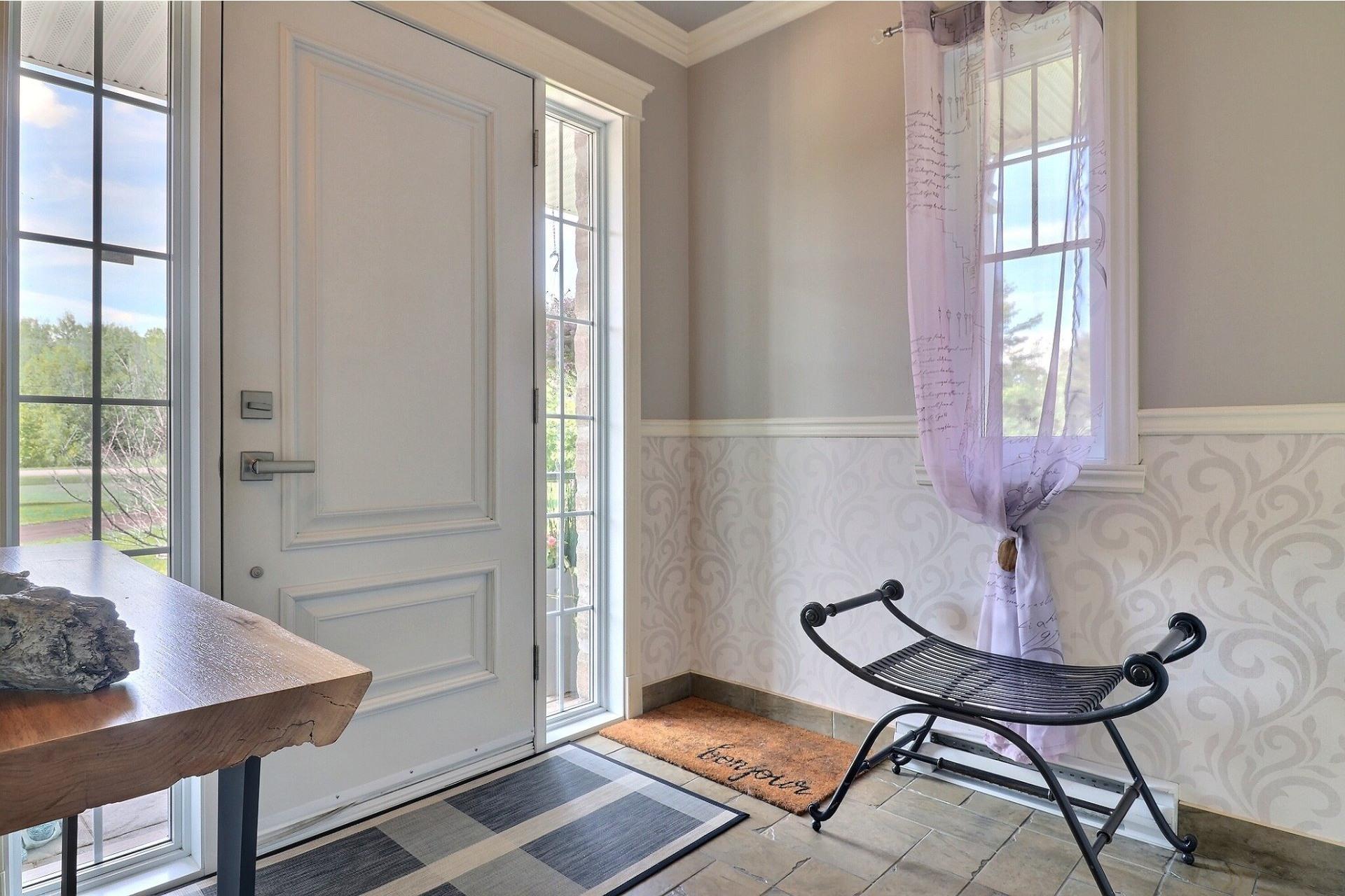 image 2 - Maison À vendre Saint-Roch-de-l'Achigan - 15 pièces