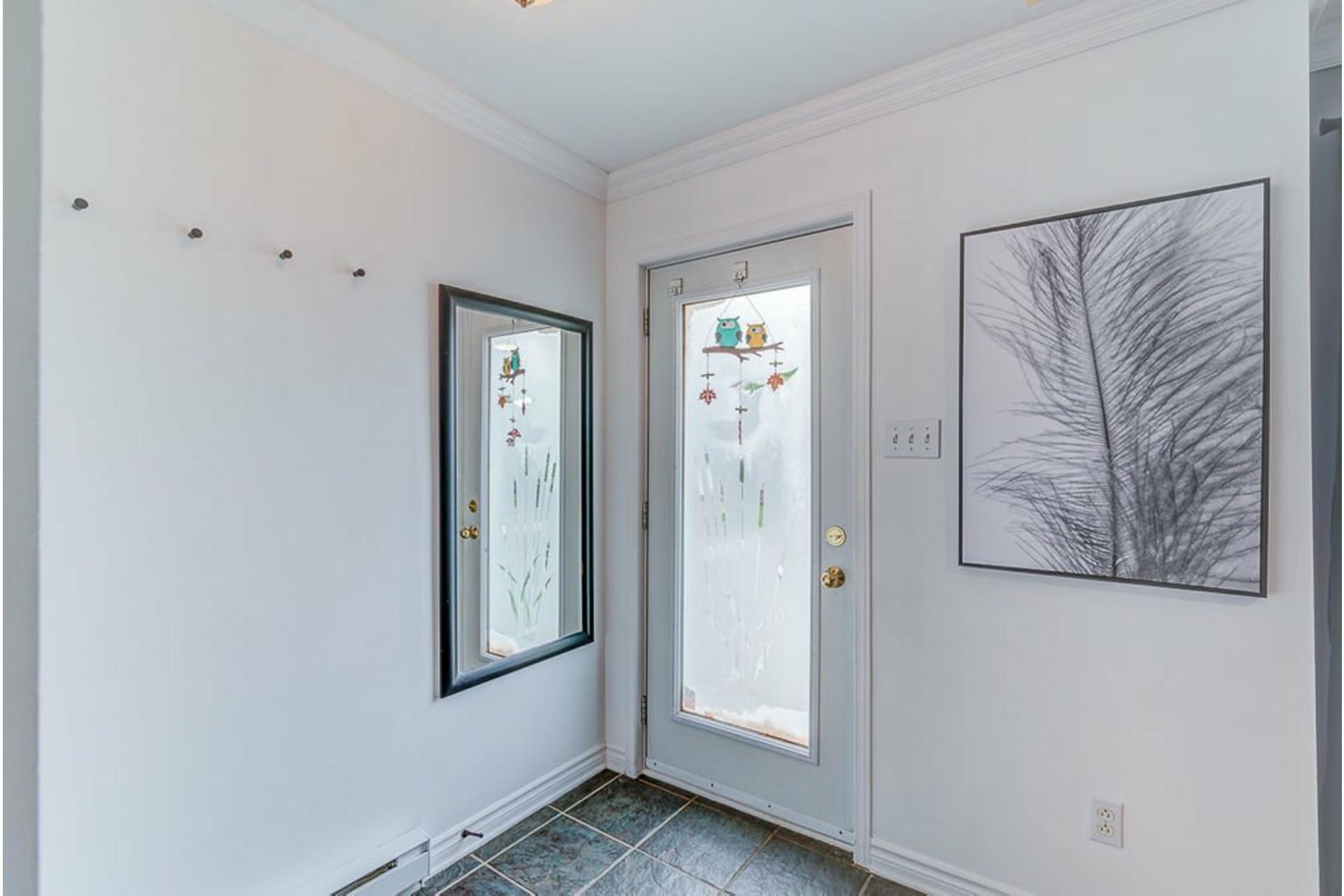 image 1 - Maison À vendre Sainte-Anne-des-Plaines - 10 pièces