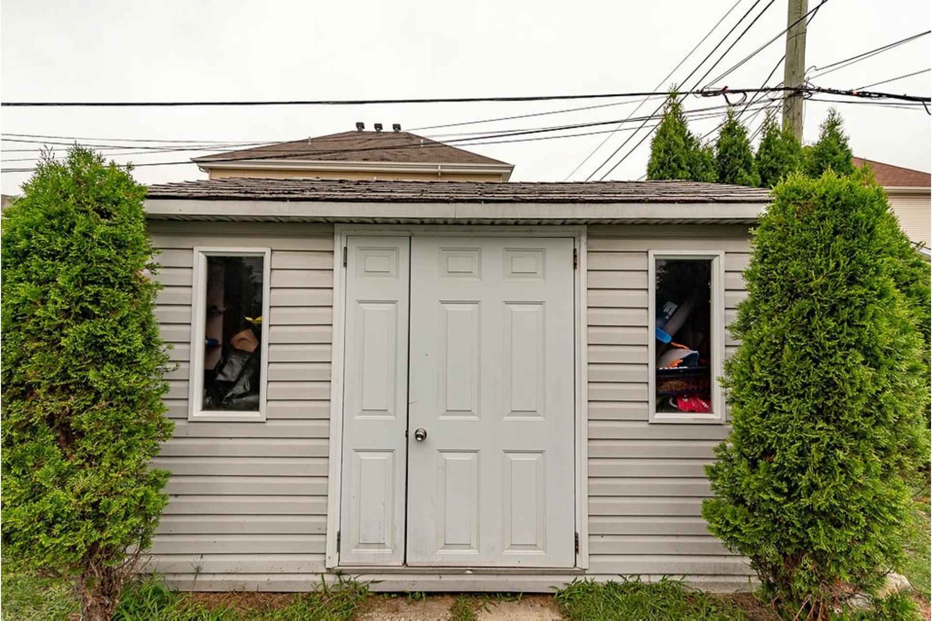 image 28 - Maison À vendre Sainte-Anne-des-Plaines - 10 pièces