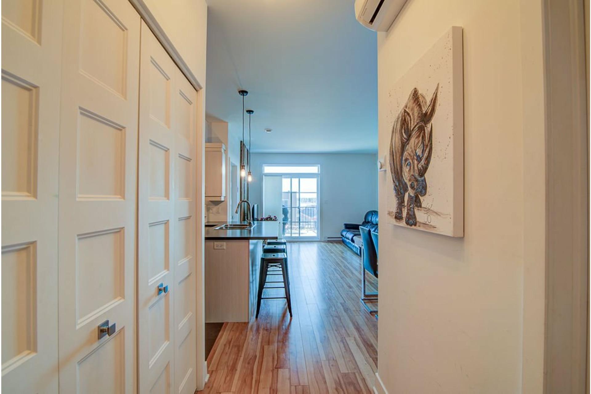 image 2 - Appartement À vendre Sainte-Anne-des-Plaines - 7 pièces