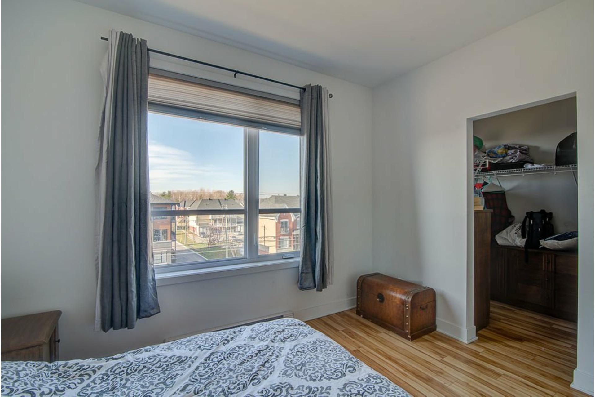 image 16 - Appartement À vendre Sainte-Anne-des-Plaines - 7 pièces
