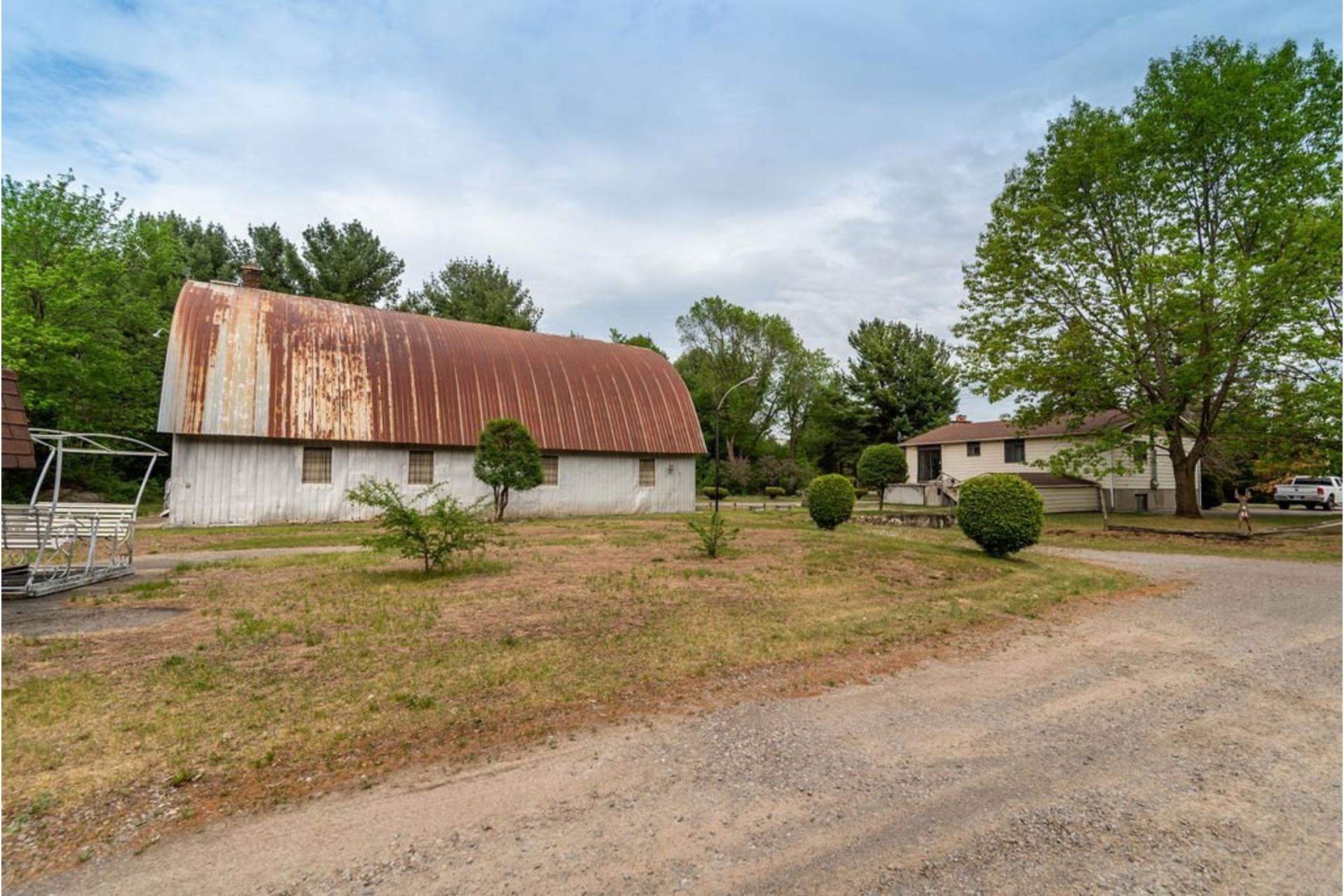 image 21 - Maison À vendre Sainte-Anne-des-Plaines - 7 pièces