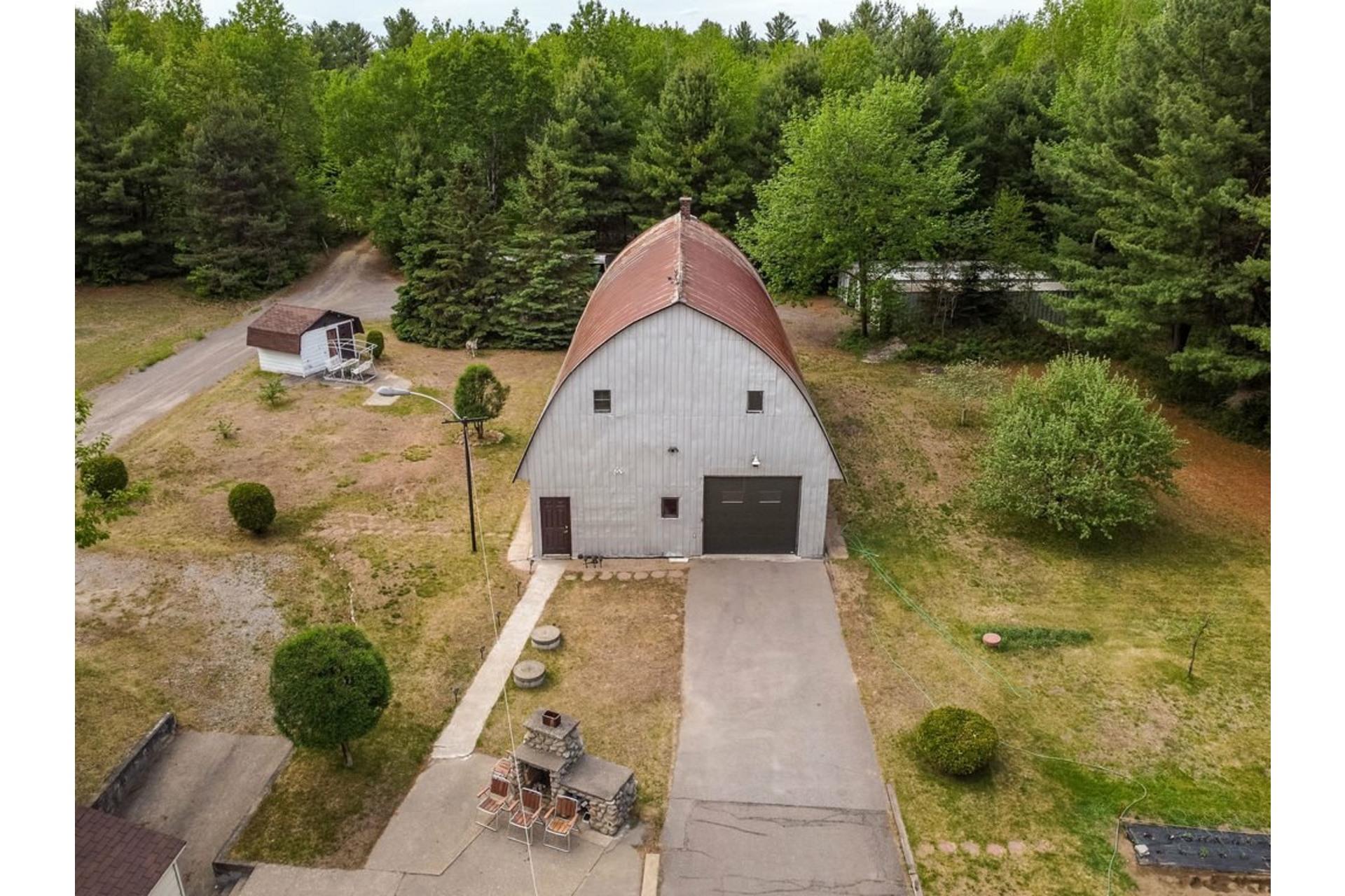 image 18 - Maison À vendre Sainte-Anne-des-Plaines - 7 pièces