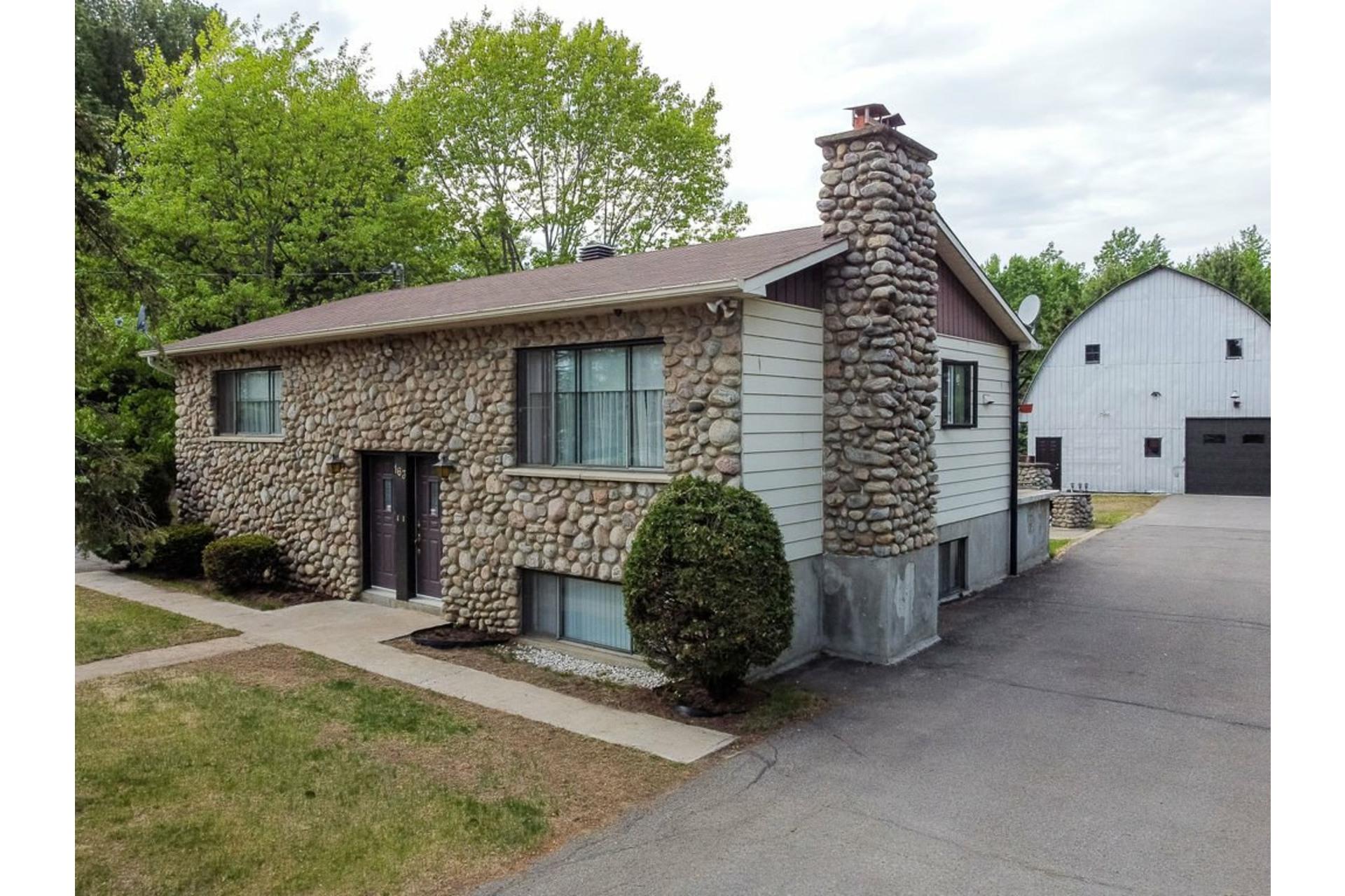 image 17 - Maison À vendre Sainte-Anne-des-Plaines - 7 pièces